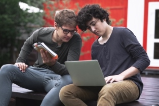 Two boys on laptops