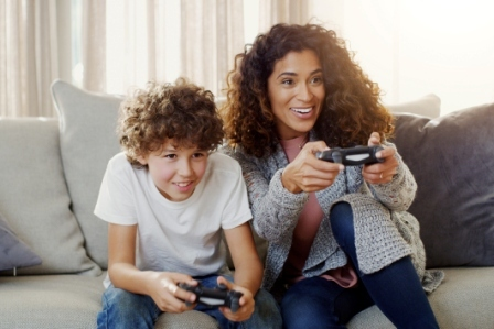 A mom and son playing a video game