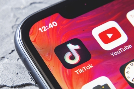 An image of the TikTok app on a smartphone